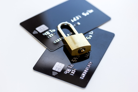 Credit cards with lock close up - online shopping on white background