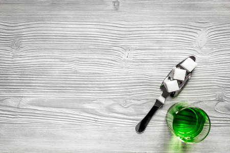 ajenjo: absinthe in glass on wooden background top view mock up
