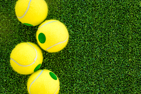 tennis ball on green background top view mock up Stock Photo