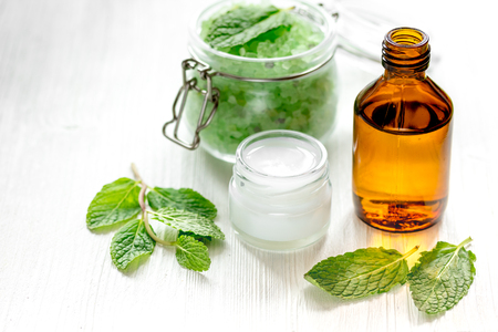 organic cosmetics with herbal extracts of mint on wooden background Stock Photo