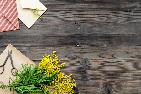 concept International Women Day with flowers on wooden background top view mock up Stock Photo