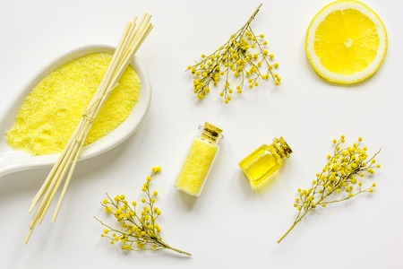Natural cosmetic with sea salt for homemade spa and organic aroma oil on white background top