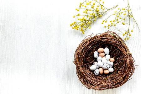 Eggs and nest for easter on white background top veiw mock-up