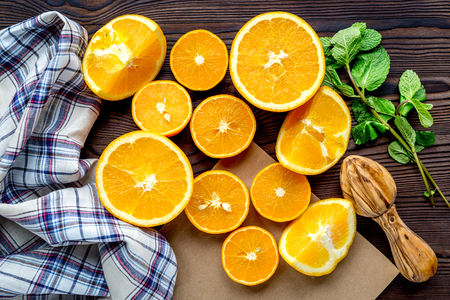 Orange juice making from fruit and mint on kitchen table top view Stock Photo