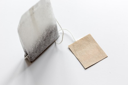 Close up black tea in teabag on white table background mock-up Stock Photo