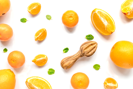 Cut oranges for juicy breakfast on white background top view pattern