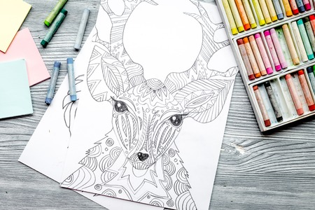 autocuidado: coloring picture for adults on wooden background top view