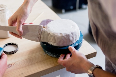 delftware: workshop production of ceramic tableware product painting