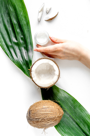 organic cosmetics with coconut on white background top view