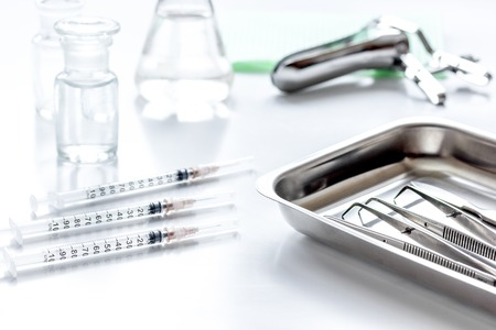 instruments of gynecologist on white background Stock Photo
