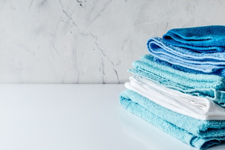 backgruond: Towels set in laudry on gray table backgruond mock up Stock Photo