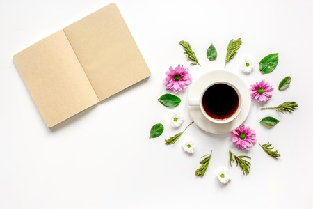 notepaper: Froral flat lay with cup of coffee and craft notepaper on white background top view mockup Stock Photo