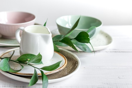 ceramic tableware with flowers on white background Stock Photo