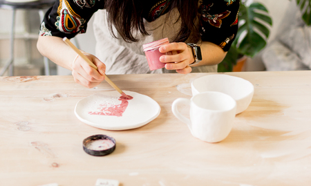 delftware: workshop production of ceramic tableware product painting.