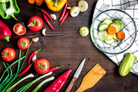 haricot: ingredients for vegetable ragout on wooden background top view