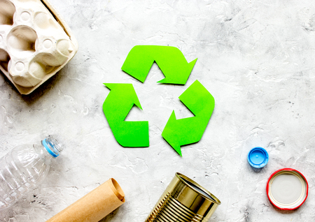 environment concept with recycling symbol on stone background top view mock-up Stock Photo