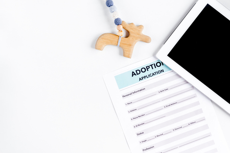 top veiw: Adoption concept with tablet and drawing on white background top view mock-up