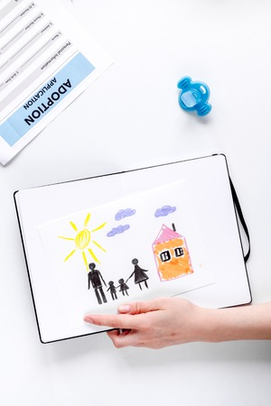 top veiw: family concept with children drawing on desk background top view mock up