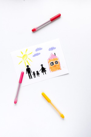 top veiw: happy family concept with children drawing on white desk background top view mock up