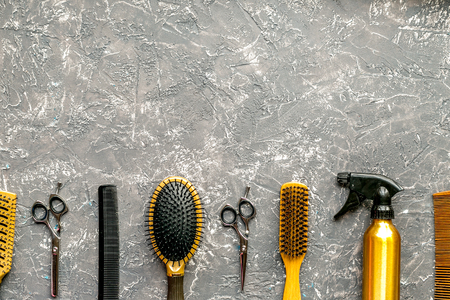 Tools for hairdress in barbershop concept on gray table background top view mock up Stock Photo