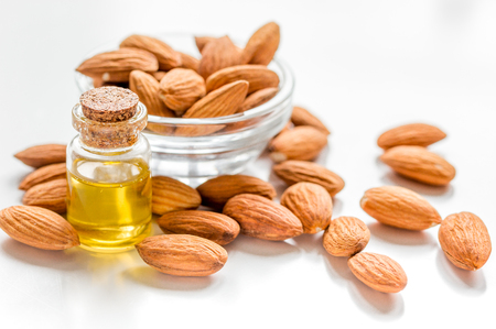 bath essence: cosmetic set with almond oil on wooden table background Stock Photo