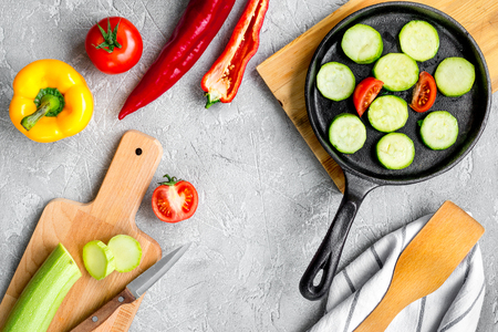 haricot: cooking vegetables on the stone background top view