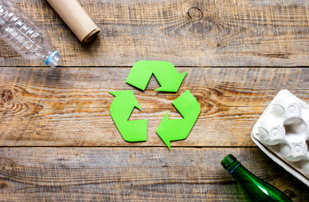 environment concept with recycling symbol on rustic background top view mockup