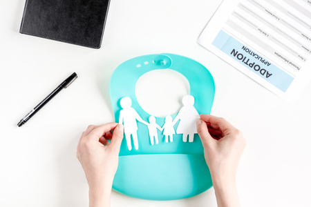 top veiw: family paper figures in adopting concept on white background top view