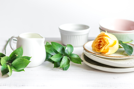 ceramic tableware with flowers on white background close up Stock Photo