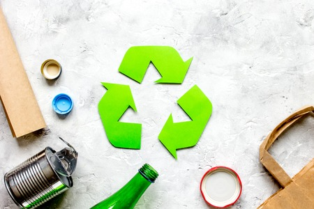 waste and recycling symbol in eco care concept on stone table background top view mock-up