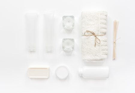white cosmetic set for body care on woman desk background top view