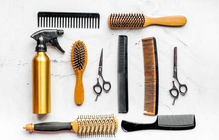 styling hair with tools in barbershop on white background top view Stock Photo