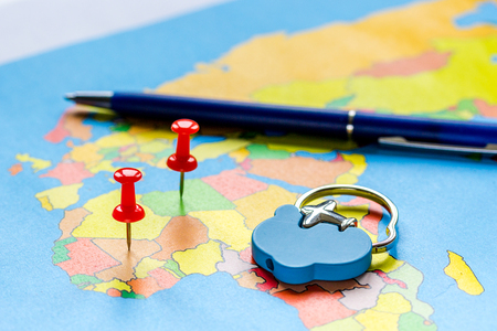 Travel preparation and booking concept on touristic map