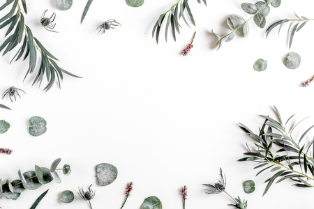 spring floral concept with green leaves on white table background top view mock-up