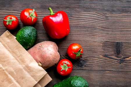 vegetables and paper bag on wooden desk background top view mock-up Stock Photo