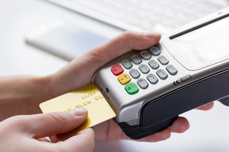 bankcard: Online payment concept with credit card and terminal on white background