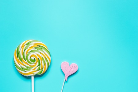 heartshaped: lollipop design with sugar candys on blue background top view mockup