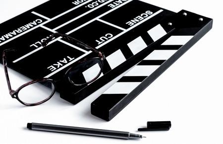 Screenwriter desktop with movie clapper board white background