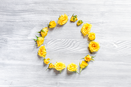 spring concept with yellow flowers on light wooden table background top view mockup Stock Photo