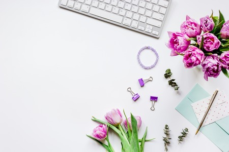 Woman office desk with flowers on white background top view mockup Фото со стока