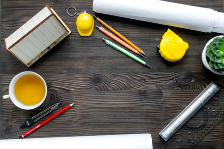 architect tools: architect office with tools and cup in profession concept on wooden desk background top view mock-up Stock Photo
