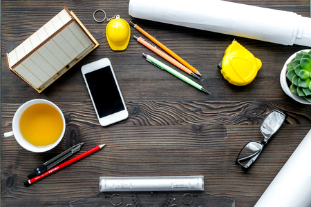 profession concept with architect desk and constructor tools and phone on wooden background top view Stock Photo
