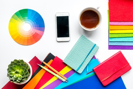 profession concept with graphic designer tools, cup of coffee and mobile on white work desk background top view