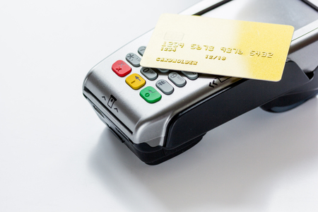 wireless terminals: purchase with payment terminal by credit card on stone desk background
