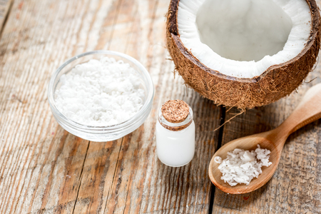 coconut oil for body care in cosmetic concept on old wooden table Stock Photo