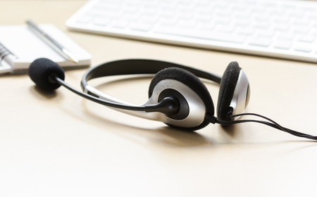 call center manager work desk with headset