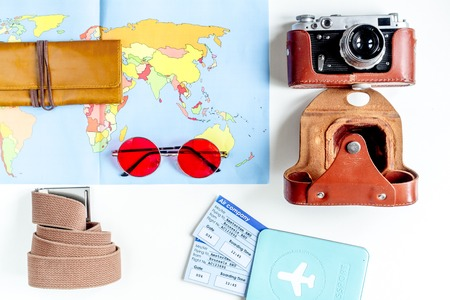 map case: vacation concept with traveller outfit on white background top view