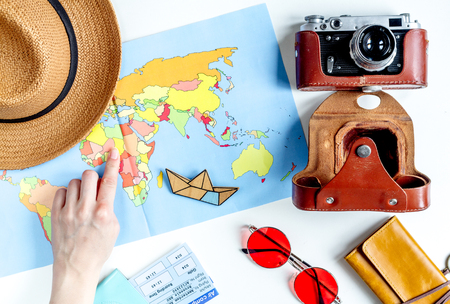 map case: journey planning with tourist outfit on white table background top view