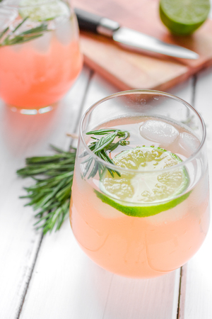 breackfast: healthy morning with fresh drink, lime and rosemary on wooden table background Stock Photo
