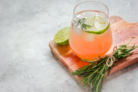 breackfast: healthy morning with fresh drink, lime and rosemary on stone table background mockup